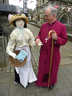 The Bishop of Sherborne is welcomed to the Coffee Morning by 'Matilda', one of the papier  maché figures that will be on show at the flower festival