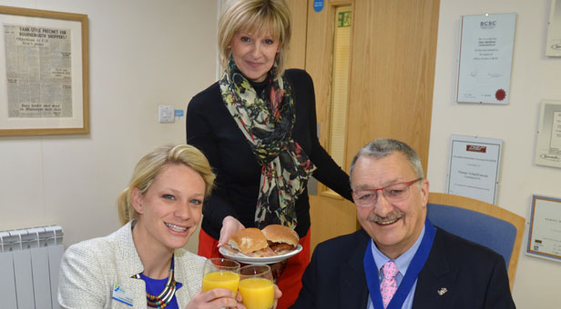 Castlepoint's Management Suite Administrator Tanya Hatcher (centre) serves Emily Pike and Peter Matthews their brekkie
