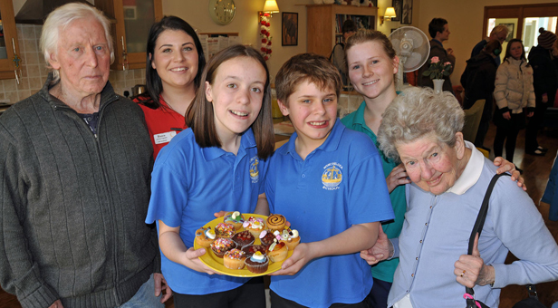Tasty treats: Winchelsea School pupils Courtney, 14, and Taylor, 12, with (left) Dennis Bushby and Jean Trill (right), both residents at Colten Care's The Aldbury, together with Bianca Turner, Activity Organiser, and Susie Deeming, healthcare assistant