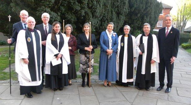 Suzie Allen with Deputy Lieutenant of Dorset, Minster Rector, Archdeacon of Sherborne, Rural Dean of Wimborne and Churchwardens from The Minster, Witchampton and Holt