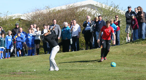 Golf professional Georgia Hall and AFC Bournemouth U21 player Jordan Holmes launching the new golf course.
