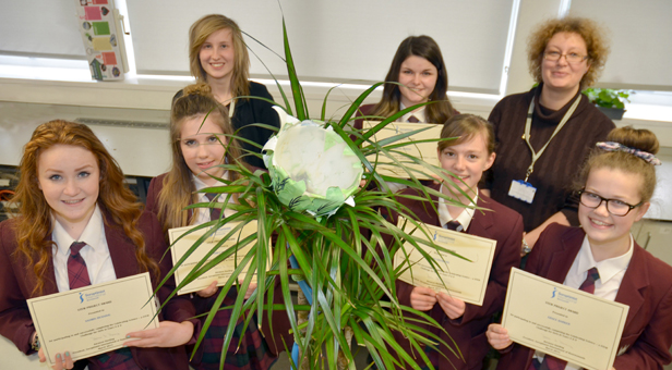 Year 9 winners (from left) Yasmin Dunning, Emily Hussey, Abigail Morton, Anna Saunders, Grace Barker with Rosanna Joyce (rear left) and Linda Green and their working model.