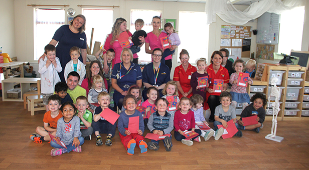 Children from Tops Day Nursery in Bournemouth present their cards to nurses