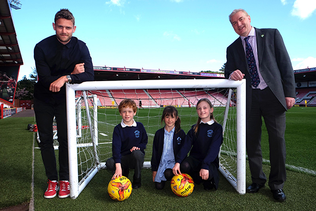 The winners with AFC Bournemouth's Simon Francis
