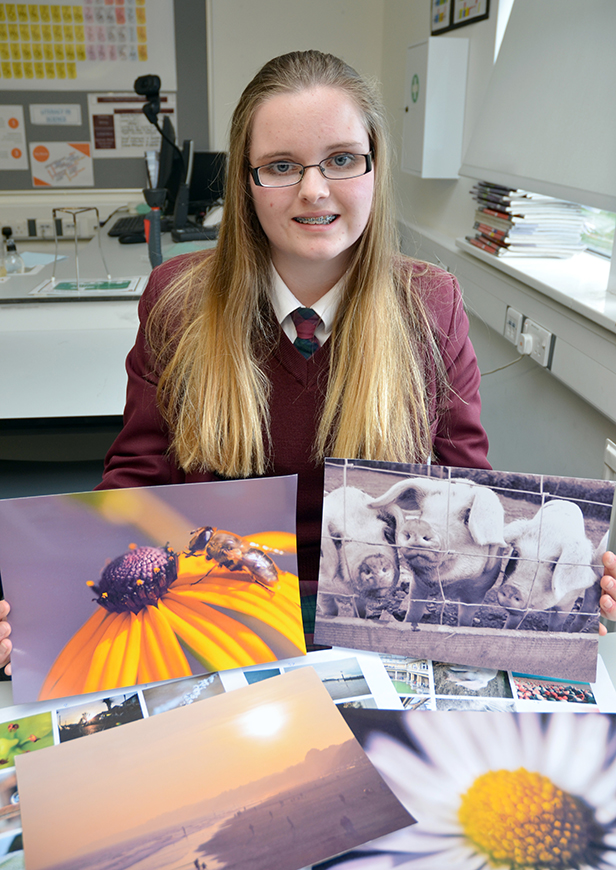 Molly Annett with a small selection of her fundraising photography