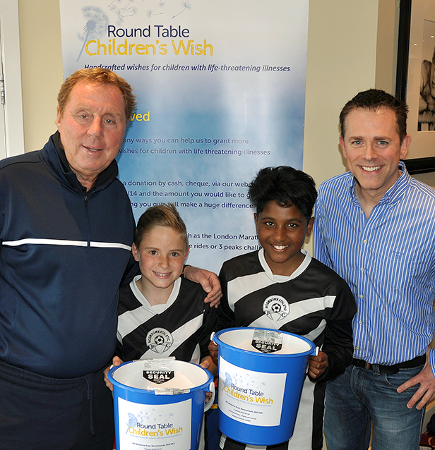 Harry Redknapp and Chris Jarvis with young footballers