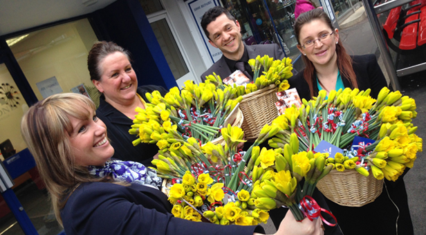 A One Insurance team delivers flowers to strangers