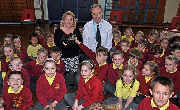 Donna Hill of Life Education Wessex, Bournemouth Water's David Harrison and Otto the Otter with pupils at Christchurch Infants School