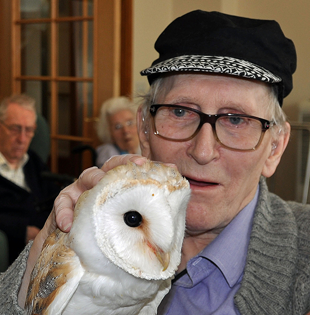 Feathered friend: Derek Coles, a resident at Colten Care's Amberwood House, meets barn owl Luna