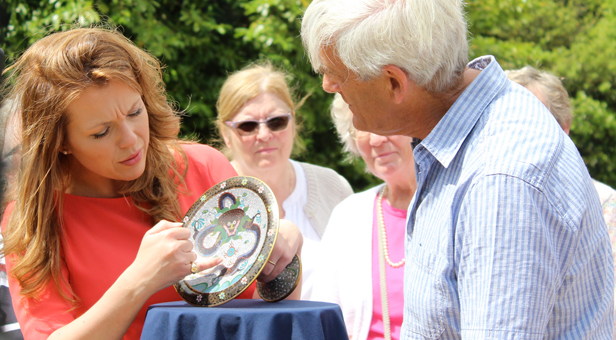 Christina Trevanion gives a valuation, seen here with the pedestal plate's owner David Parker