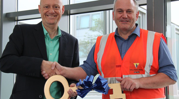 Right on time: Lawrence Vincent, left, congratulates Nick Rodgers, Willmott Dixon's construction manager on the project as the building is released for fitting out. It opens to students in September.