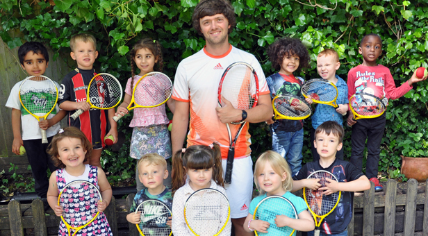 Tennis coach Will Bound with some of the children from the Bournemouth Day Nursery