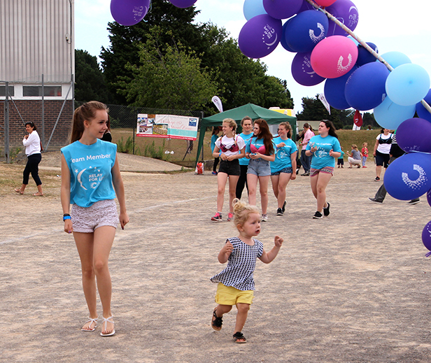 DARCIE OVAL (Aged 2): One of the youngest participants to walk a whole lap, pictured here with watchful team member Demi