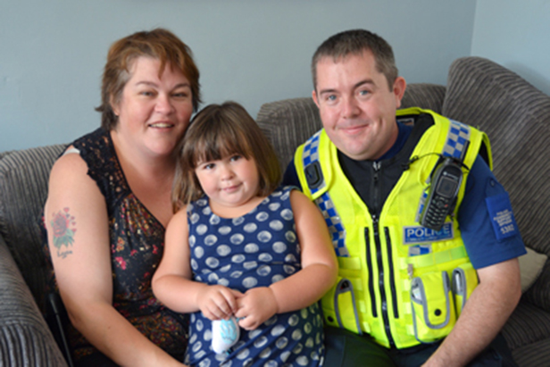 PCSO Adam Cleaver, Emily Williams and her mum Donna Wilson