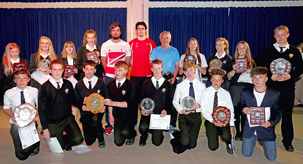 Team GB Handball star John Pearce (centre left) and Octathlete, Nick Hunt (centre right) celebrate the achievements of Avonbourne and Harewood college's Sports Personality of the Year competition winners