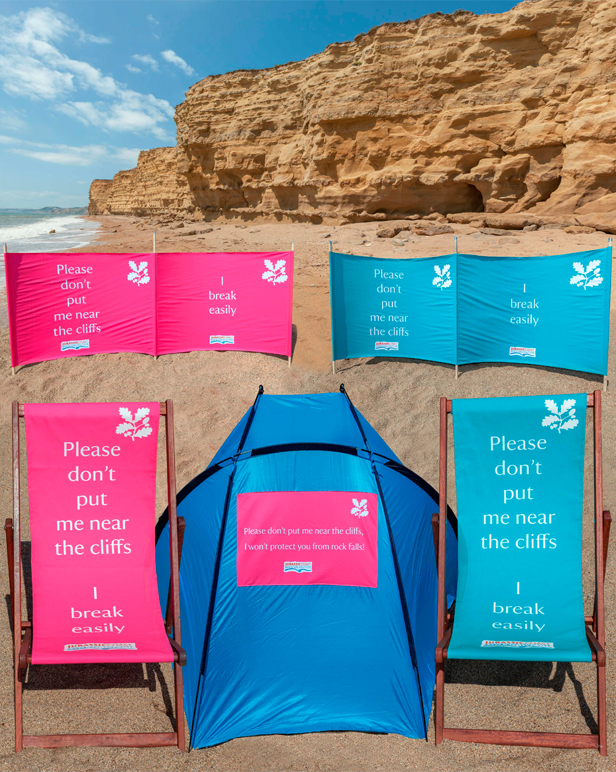 Deckchairs, windbreaks and shelters on the beach at Burton Bradstock © National Trust/Tony Gill