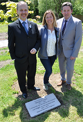 Malcolm Green, Kate Cross and Mark Alder, with the Purbeck stone memorial.