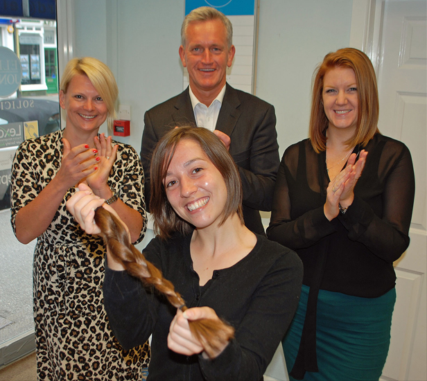 ...Gone tomorrow: Colleagues at Ellis Jones' Canford Cliffs office applaud Annie after she donates ten inches of her hair to the Little Princess Trust