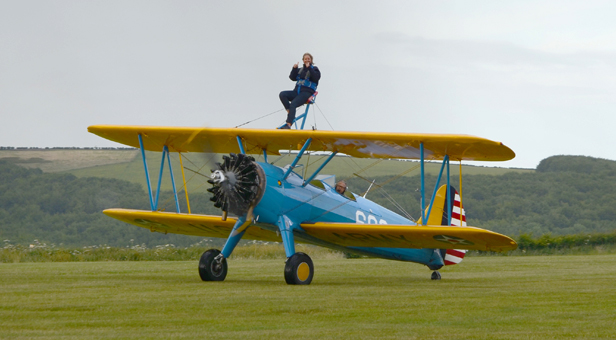Tanya Hatcher on the top wing of the Stearman biplane