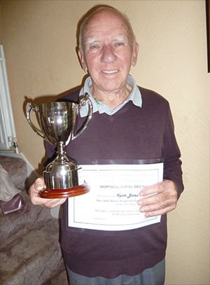 Keith Bates with his trophy and winning certificate