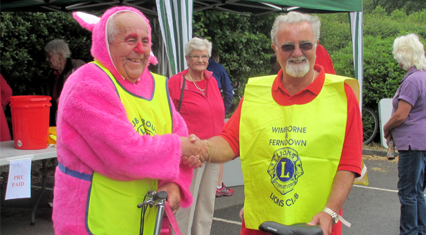 W&F president Barry Duxbury with Bournemouth Lions president Barrie Haynes in rabbit suit