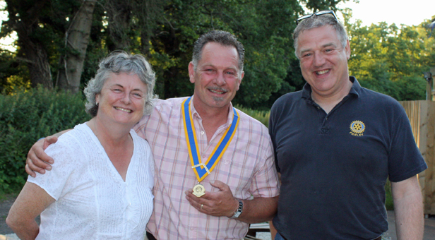 The new president of Parley Rotary Club, Shane Dart (centre), pictured with outgoing president Paul Du Lieu and Dorset district governor Debbie Dunford.