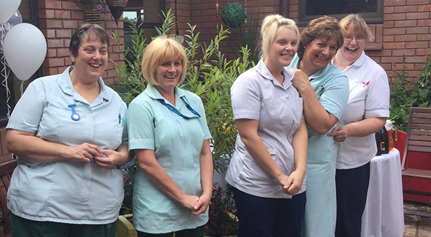 Blandford Hospital team celebrating the wedding