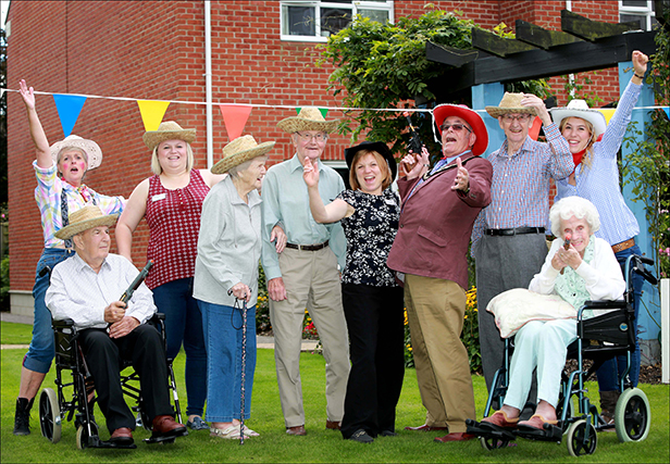 Colten Care's Kingfishers care home in New Milton held a cowboy themed summer barbecue to welcome back Home Manager Rebecca Hannam (centre) from maternity leave New Milton Mayor Cllr David Hawkins joined in the fun