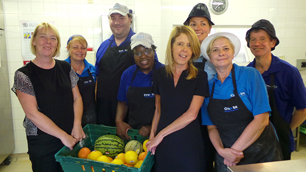 Crumbs volunteers receiving a tray of FareShare products