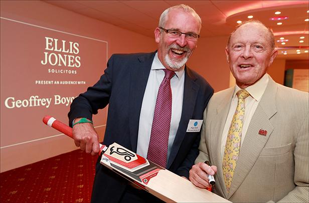 Cricketing legend Geoffrey Boycott OBE signs a cricket bat for Nigel Smith, Managing Partner, Ellis Jones