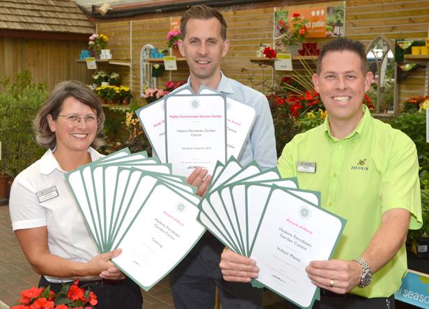 Restaurant supervisor Amanda Bartlett, Matt Hill and outdoor manager Kevin Holmes with the 18 merits