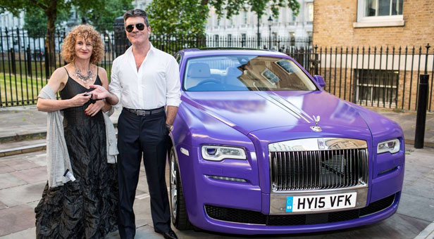 Simon-Cowell-presents-Rolls-for-charity-hire