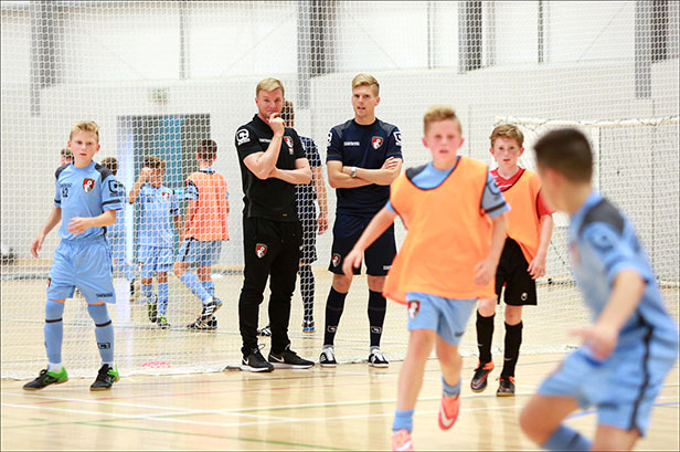 Eddie Howe oversees a training session at the new sports facility at the LeAF Academy