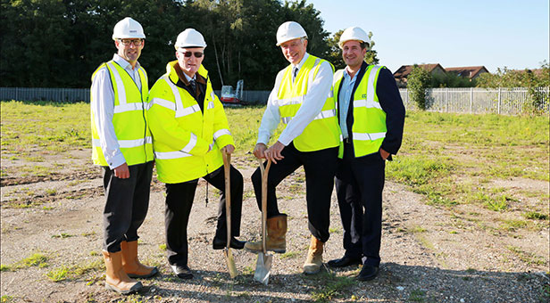 Colten Care founders Adrian Otten and John Colwell (centre left and right) with their sons and directors Rick Otten and George Colwell as work begins on the site of their new Ringwood offices