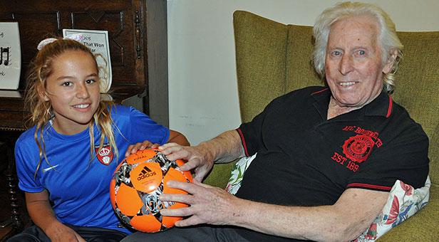 Mia Cruickshank, 13, with former Cherries player Dennis Bushby