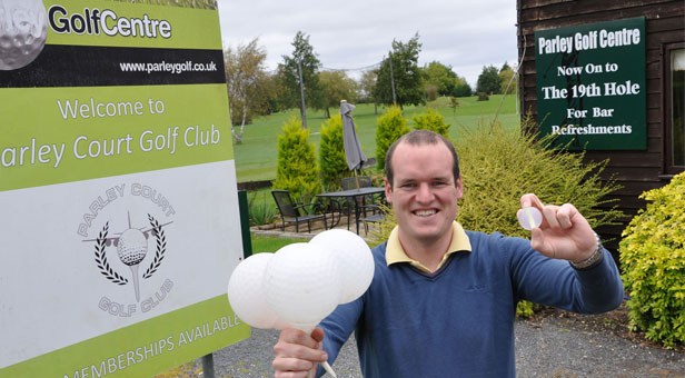 Daryl Dampney of Parley Golf Centre with some of the equipment used for night golf