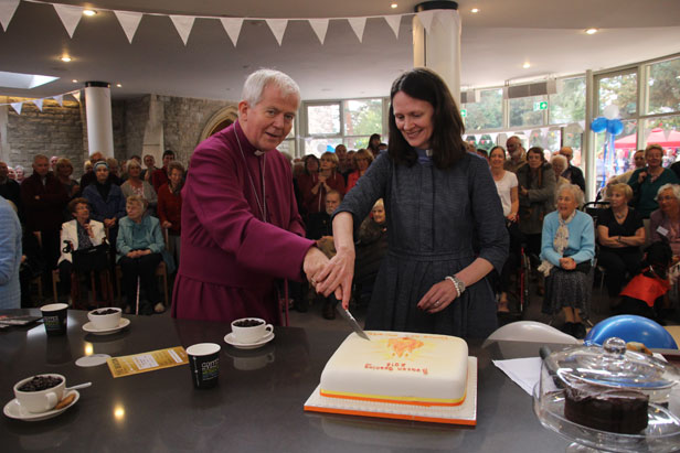 The Bishop and the Vicar cut the cake