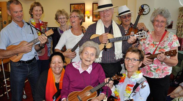MUSIC TO MY EARS. Phyllis Walker (seated centre), a resident at Colten Care's Amberwood House in Ferndown, with her daughter Jackie Brooks (seated right) and Jackie's bandmates Jo Cartlidge (seated) and, standing from left: John Granger, Sue McLachlan, Judy Weldon, Claire Mills, Fred Shepherd, Ken Ranford and Jools Kane.