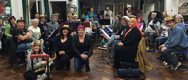 Christchurch and District Band at their last rehearsal sporting headgear to support member