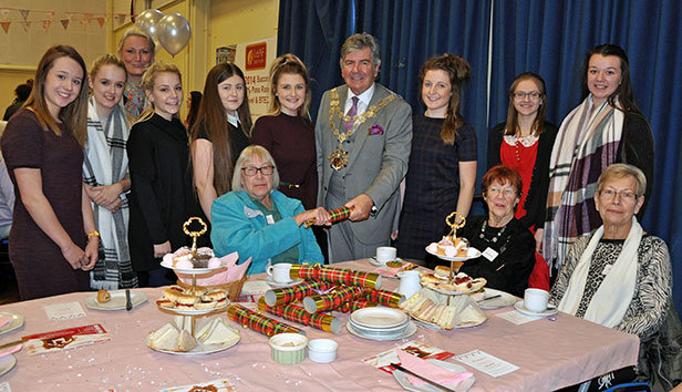 Students and party organisers join guests and the Mayor of Bournemouth, Cllr John Adams, for the Faithworks' celebration event hosted by the LeAF Academy
