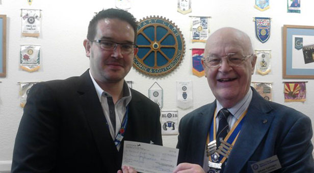 Boscombe and Southbourne Rotary Club President Brian Tuffrey presents Barry Wilson from Bournemouth Hospital Charity with the proceeds from last year's event.