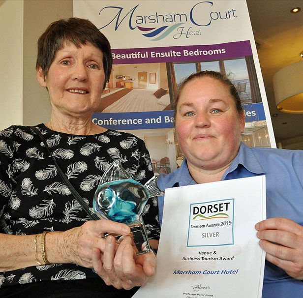 FAMILY HONOUR: Rosie Wallace (right) and her mother Jennie Deavin cradle their Dorset Tourism Award