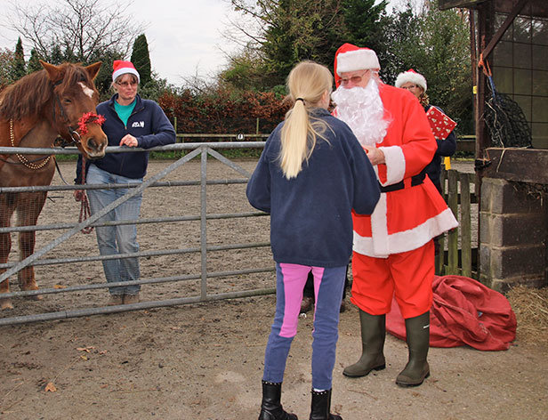 Santa hands out gifts at Green Cottage RDA