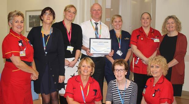 The RBCH Quality Improvement Team with their Health Business Award for patient safety. Back row (from l-r) Head of nursing Kate Horsefield, Associate Lead of Clinical Governance and Risk Management Joanne Simms, Consultant Dr Scott, Medical Director Basil Fozard, Nurse Samantha Hornby-Wykes, matron Alison Pressage and Director of Improvement Deb Matthews. Front row (from l-r) matron Sue Langlois, Improvement Programme Manager Geraldine Sweeney, matron Diane Potter.