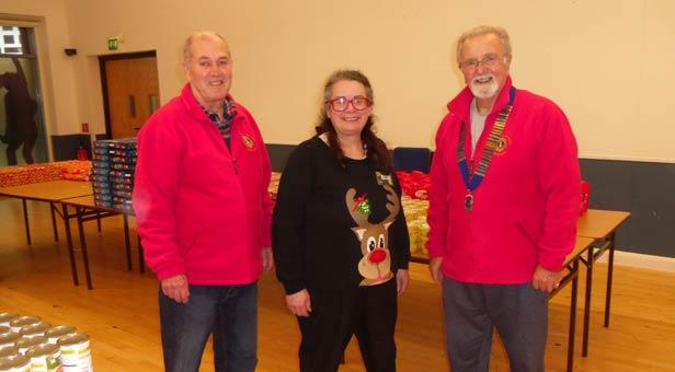 Jenny Cook flanked by Lions Godwin Micallef and Barry Duxbury