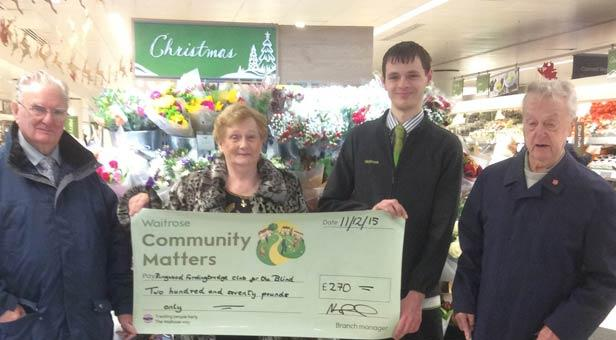 Jean and Gerry Postill and John Reading being presented with cheque from Waitrose