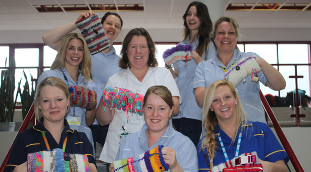 RBH specialist dementia nurses Rachael Davies and Kelly Lockyer show off the twiddle mitts with BU student midwives Alison Peters and Hannah Pilling, BU student occupational therapist, Siana Kennelly and BU student adult nurses Beth Gibson, Michele Miles and Suzanne Slater