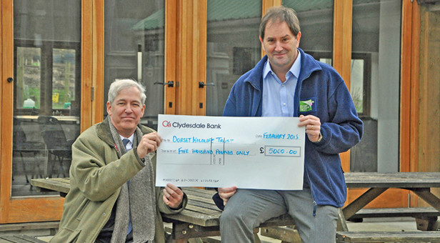 From left, Rupert Vaughan and Simon Cripps in front of Swallow Barn at the trust's Kingcombe Centre near Maiden Newton