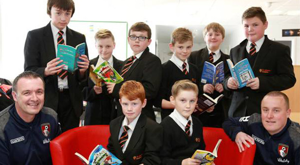 YOU'RE BOOKED!: AFC Bournemouth's Head of community Steve Cuss (left) and operations co-ordinator Andrew Battison, with some of their new Reading Stars