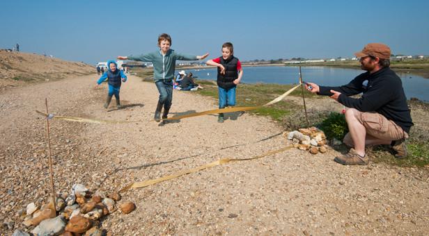Children enjoying last year'sWild Play Day atHurst Spit.